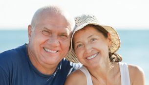 Portrait of Happy smiling mature couple against sea and sky